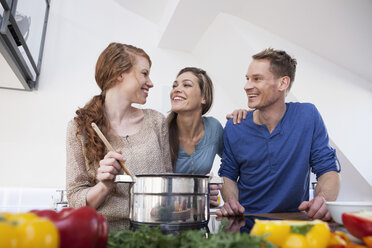 Three friends cooking together - RBF001587