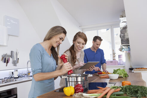 Three friends cooking together - RBF001506