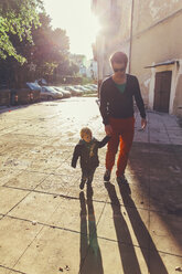 Italy, Sicily, Palermo, Father and son talking a walk - MFF000757
