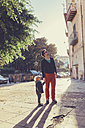 Italy, Sicily, Palermo, Father and son talking a walk - MFF000744