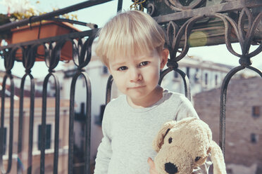 Italy, Sicily, Palermo, Blond boy on balcony - MFF000750