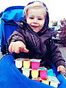 Child in his stroller with a bunch of yoghurts, Bonn, North Rhine-Westphalia, Germany - MEA000050