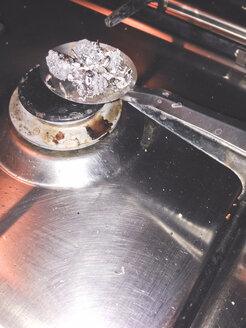 Lead poring tradition with lead being heated up over stove, Palermo, Sicily, Italy - MEAF000083