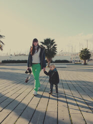 Mother and son walking along the promenade, Palermo, Sicily, Italy - MEAF000093