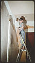 Child on the head, helps painters, Baden-Wuerttemberg, Germany - SBDF000422