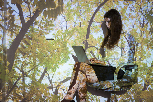 Young woman in nature  projection using laptop - BGF000082