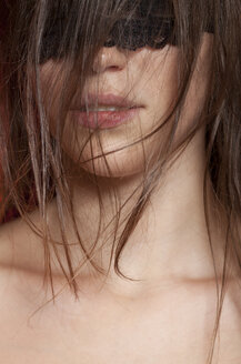 Young woman with covered eyes, close up - BGF000054
