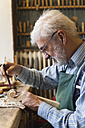 Violin maker at work - TCF003809