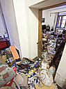 Austria, view to living room of a person with hoarding disorder - DIS000331