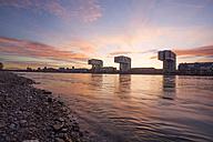 Germany, North Rhine-Westphalia, Cologne, Crane houses at Rheinau harbour by twilight - JAT000564
