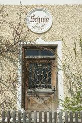 Germany, Bavaria, Toelzer Land, Door of abandoned school - CR002564