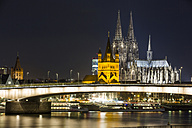 Germany, North Rhine-Westphalia, Cologne, view to Deutz Bridge, Great St Martin and Cologne Cathedral by night - JATF000571