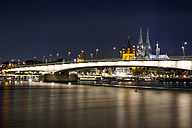 Germany, North Rhine-Westphalia, Cologne, view to Deutz Bridge, Great St Martin and Cologne Cathedral by night - JATF000572