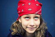 Portrait of smiling girl with red headscarf - PAF000245