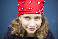 Portrait of smiling girl with red headscarf - PAF000247