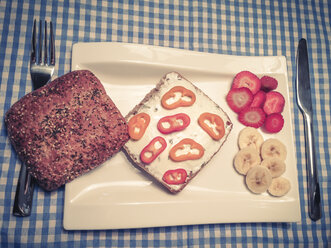 Healthy breakfast with wholegrain Ciabatta bread roll, cream cheese with sliced ??peppers and fruits - ABAF001176
