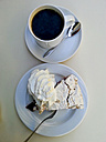 Cup of coffee and cherry pie with whipped cream, Germany - CSF020667