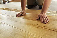 Man laying finished oak parquet flooring, close-up - BIF000295