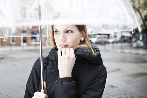 Young woman holding transparent umbrella - FEXF000053