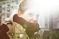 Portrait of freezing young woman in sunlight - FEXF000061
