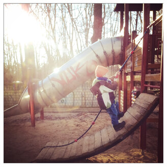 Toddler climbing at a Playground, Berlin, Germany - MVC000061