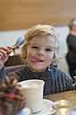 Smiling blond boy in a cafe, portrait - MJF000629