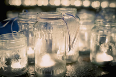 Lots of tea lights in jars - MJF000600