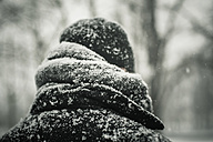 Man in black jacket in snow, close-up - MJF000605