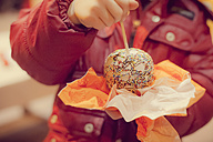 Boy eating candy apple, close-up - MJF000697