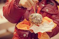 Boy eating candy apple, close-up - MJF000697
