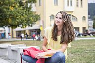 Germany, portait of smiling teenage girl watching something - VTF000063