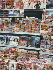 Women's magazines and TV in news stand at a supermarket, Bonn, NRW, Germany - MF000803
