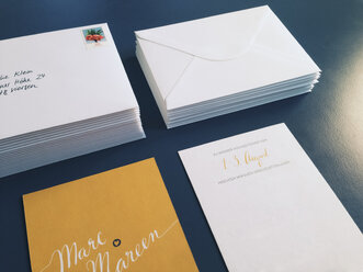 Wedding invitations and envelopes laying on a table, Bonn, Germany - MF000781