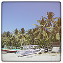 Indonesia, Lombok, Palms at beach with fishing boats - KRPF000113