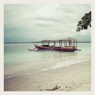 Indonesia, Gili Islands, Beach with traditional fishing boat - KRPF000106