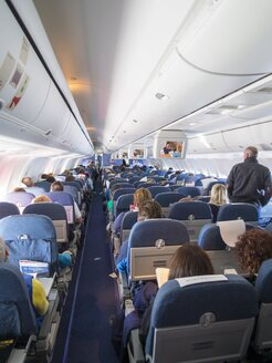 Cabin of aircraft Boing 767 with passengers - AM001725
