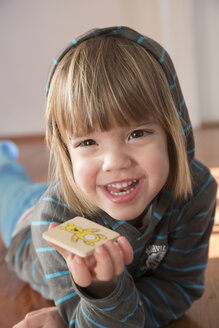 Portrait of smiling little girl with hoodie sweater - LV000490