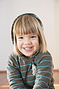 Portrait of smiling little girl wearing hoodie sweater - LVF000493