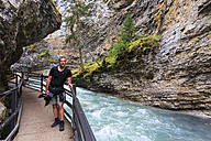 Canada, Alberta, Banff National Park, Johnston Creek, Johnston Canyon, tourist on footbridge - FOF005734