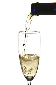 Pouring sparkling wine into champagne flute - YFF000009