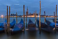 Italy, Venice, Gondolas at San Giorgio Maggiore at night - FO005644