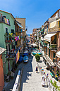 Italy, Liguria, La Spezia, Cinque Terre, Manarola, view to alley with residential houses - AMF001762