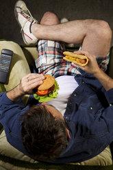 A man eats junk food - MAEF007683