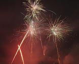 Germany, Bavaria, Kochel am See, fireworks at night sky - LAF000475