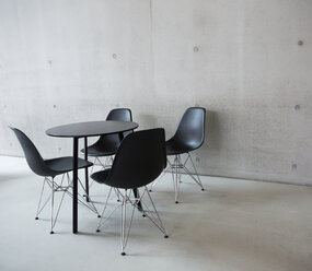 Italy, Rome, four black retro chairs and a table at museum MAXXI - DIS000447