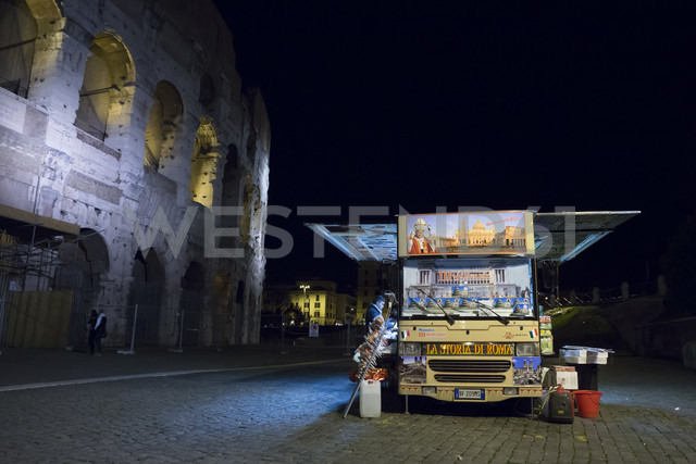 Italy, Rome, truck used as kiosk, standing in front of Colosseum at night - DIS000431