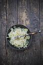 Bowl of sauerkraut on wooden table - LVF000505