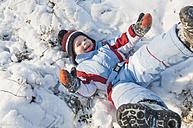Germany, little boy having fun in snow - MJF000770
