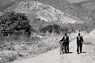 Malawi, Chitimba, Livingstonia, two men wearing suits on the way to sunday mass - JBA000001