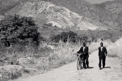Malawi, Chitimba, Livingstonia, two men wearing suits on the way to sunday mass - JBA000001